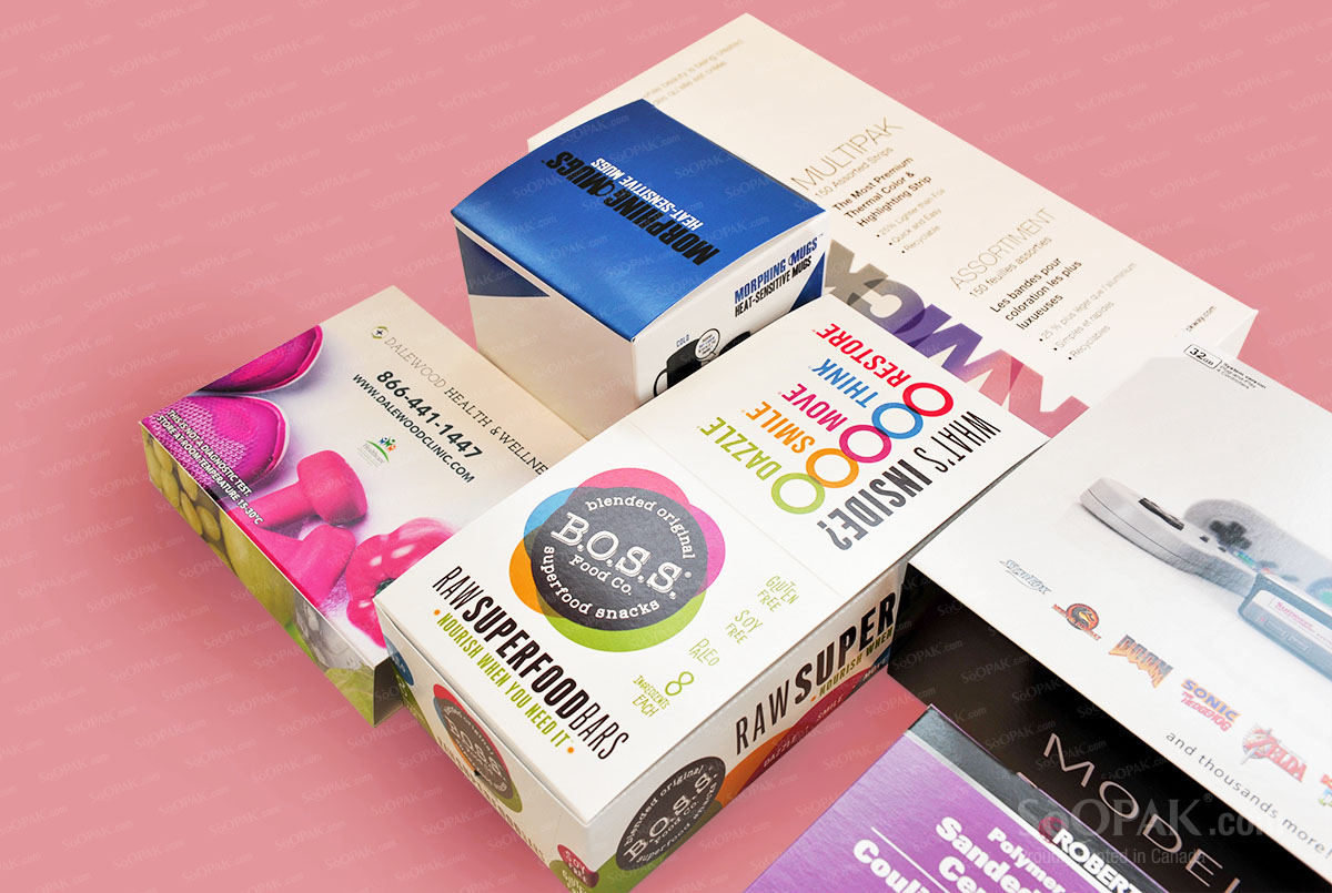 packages laid out on pink background